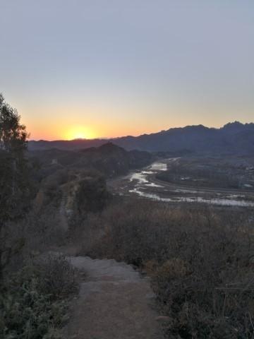 Le coucher du soleil depuis la Grande Muraille